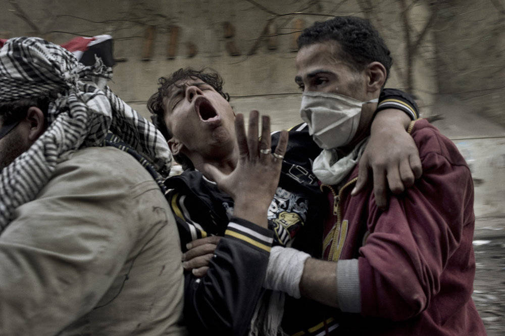 Cairo  Egypt  November 23, 2011: A protester overcome by tear gas is evacuated from Mohamed Mahmoud street, November 23, 2011.