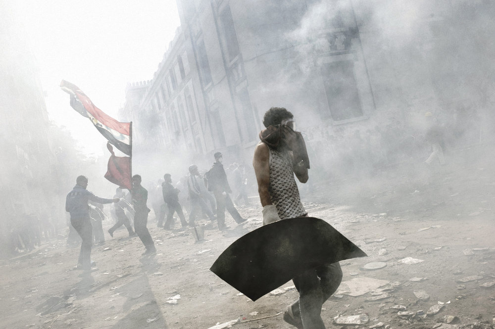 Cairo  Egypt  November 23, 2011: Tear gas fired by Egyptian security forces blankets a group of protesters, November 23, 2011.