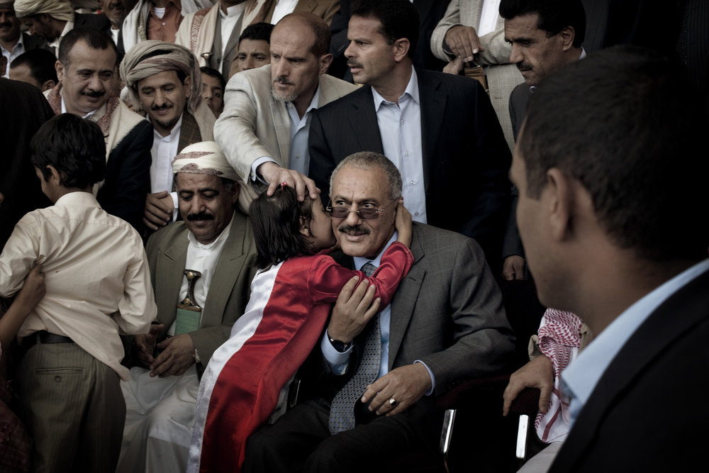 "SANAA YEMEN-- MAY 2011:  A  young  supporter  kisses Yemeni President Ali Abdullah Saleh during a pro-government rally in Sana'a,   in a defiant speech to thousands of flag-waving supporters in the Yemeni capital, Saleh declared: ""We will confront a challenge with a challenge."""