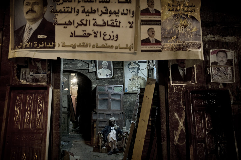 SANAA YEMEN-- MAY 2011:  A  shop with the  posters of Yemen's President Ali Abdullah Saleh   at  the old  town  of Sanaa
