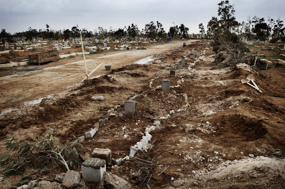 BENGHAZI, LIBYA - FEBRUARY 25: Freshly dug graves appear at the cemetery in Benghazi.