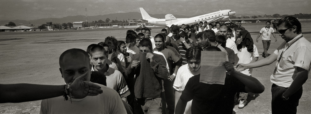 Guatemala, Guatemala City, July 2008, Deported men and women depart a flight that just arrived from the United States to La Aurora Airport.