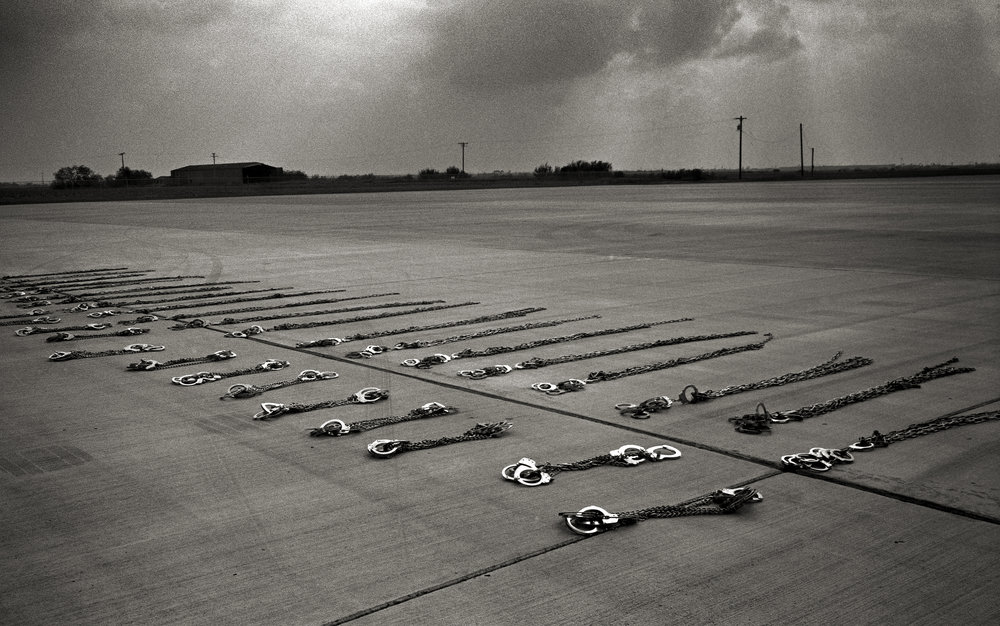 Texas, Harlingen, December 2009, Handcuffs lie on the ground before being put away after shackling a group of undocumented immigrants who were being transported from Pennsylvania to the border crossing at Hidalgo.