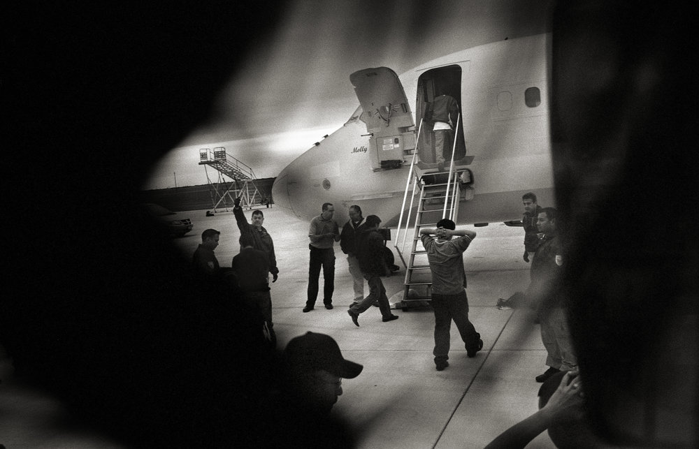 Texas, Brownsville, December 2009, Guatemalan nationals are loaded onto an airplane named Molly at a municipal airport. The flight flew directly to La Aurora Airport in Guatemala City where the men and women were returned to their homeland.