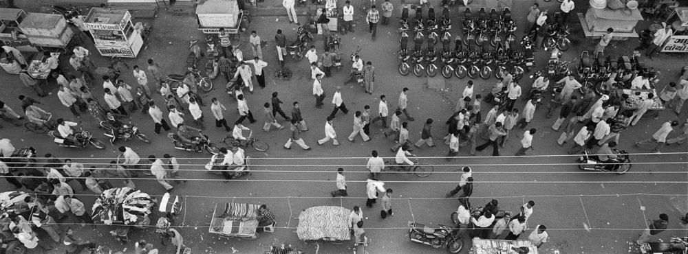 India, Surat, 2007, People walking on street.