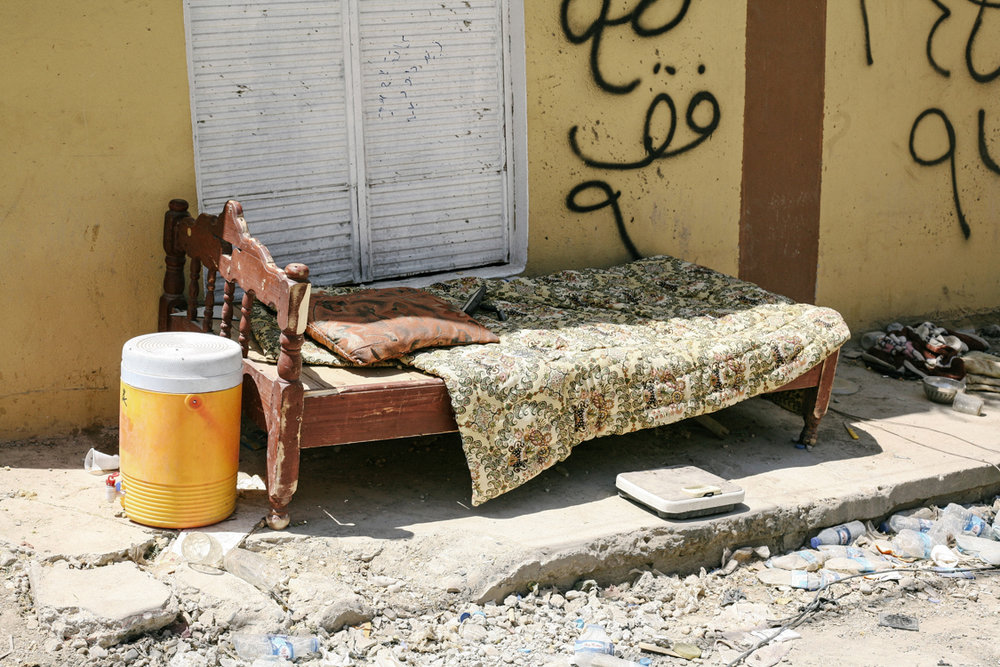 A bed in the streets of Mosul. Iraq, May 2017.