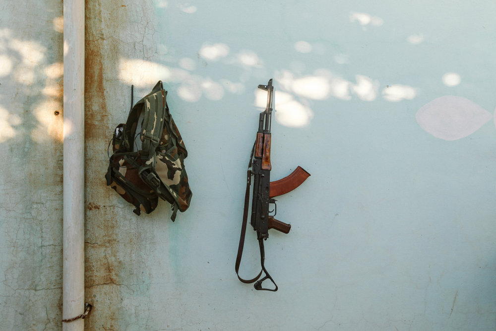 Equipment of a young soldier: bag and rifle. Sinjar, Iraq, November 2015.
