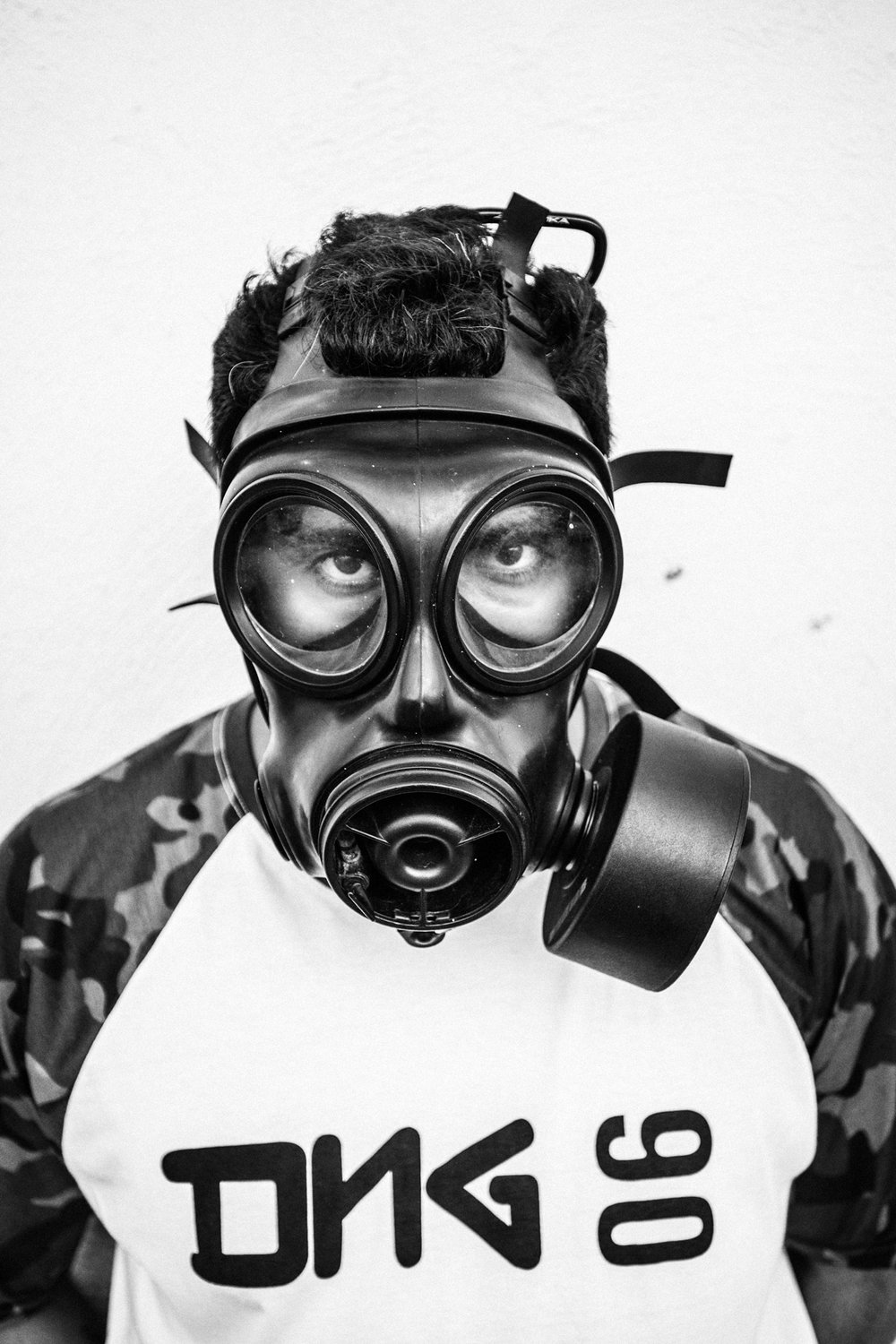 February 2015 - Rio de Janeiro, Brazil: Raul, one of the members of Papo Reto collective, posing with a gas mask