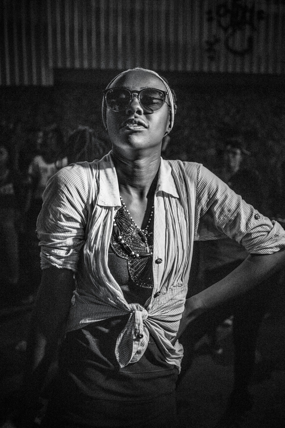 RIO DE JANEIRO, BRAZIL - MAY, 2014: Funk dancer during a charme party under a bridge in the favela of Madureira in Northern Rio.Any number of influences can be found in Brazil?s funk music, a diverse and dynamic genre which has become a worldwide cultural phenomenon, booming far from the favelas, where the carioca funk was born. But for those inhabitants of Rio de Janeiro who are not part of the bourgeoisie and whose reality unfolds in the adjacent favelas, funk signifies not only a music genre, but also a dance, a beat and a way of talking about hardship. In no other music genre is there such an aggressive assertion of sexuality, masculinity, oppression, poverty and law-defying uprising. This is then counter-balanced by a humbling presence of lyrics focusing on black pride, dignity in the face of injustice.