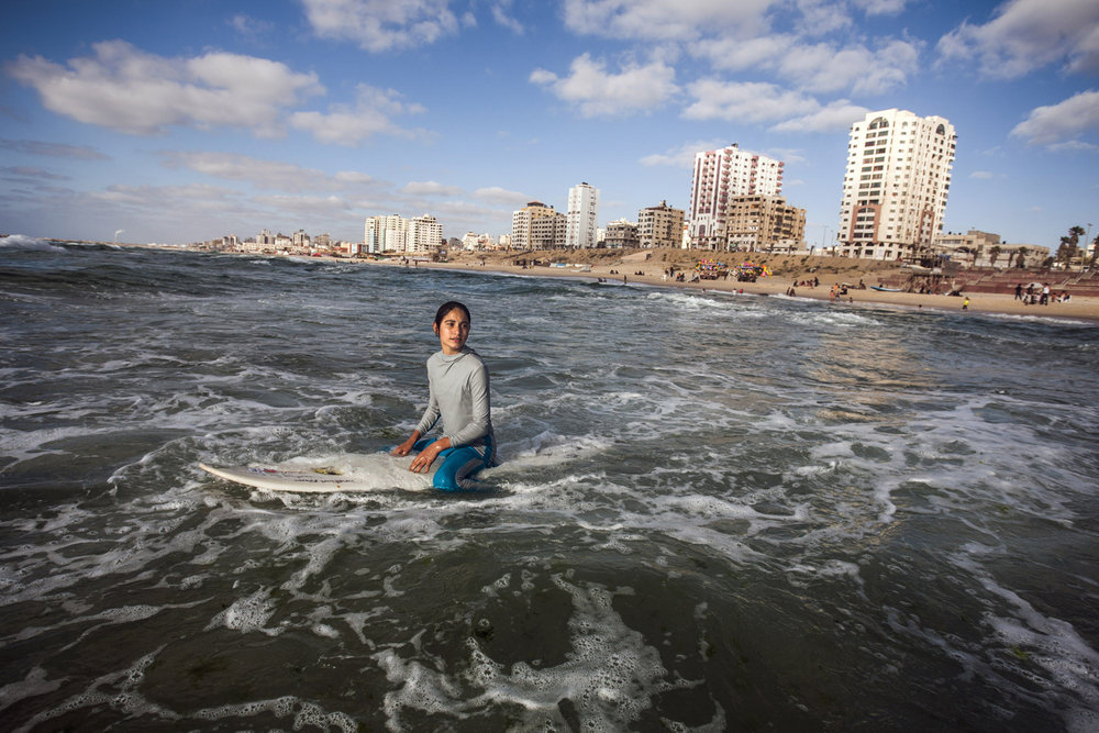Occupied Palestinian Territories, Gaza, Gaza City, 26 May 2013Sabah Abu Ghanem, 14, waits for a wave on a slow surf day.