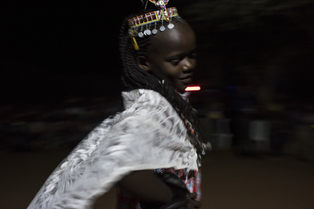 Kenya, Amboseli, 07 December 2017Hariet Sainapei participates in a type of pageant and nighttime celebration as part of an alternative rights of passage ceremony.In the Maasai village of Lenkisem, girls between 9-16 participate in a two-day ceremony that brings girls from surrounding villages to one school. They bonded while being educated on their basic rights and why FGM (female genital mutilation) is unhealthy.  They celebrated womanhood with dance, song and pageantry, and, in the end, were recognized by their community, a local NGO and village elders.This is one of dozens of approaches, by local communities and grassroots NGOs, to re-imagine the teenage right of passage and replace the widely practiced FGM ceremonies that are traditionally held in Maasai culture.Andrea Bruce / NOOR