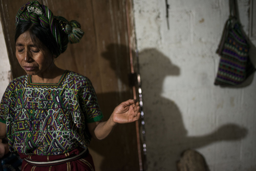 Nebaj, GuatemalaJacinta Ramirez Brito, 43, prays for the safety of her family and Cecilia in her small tin-roof home in El Paraiso.