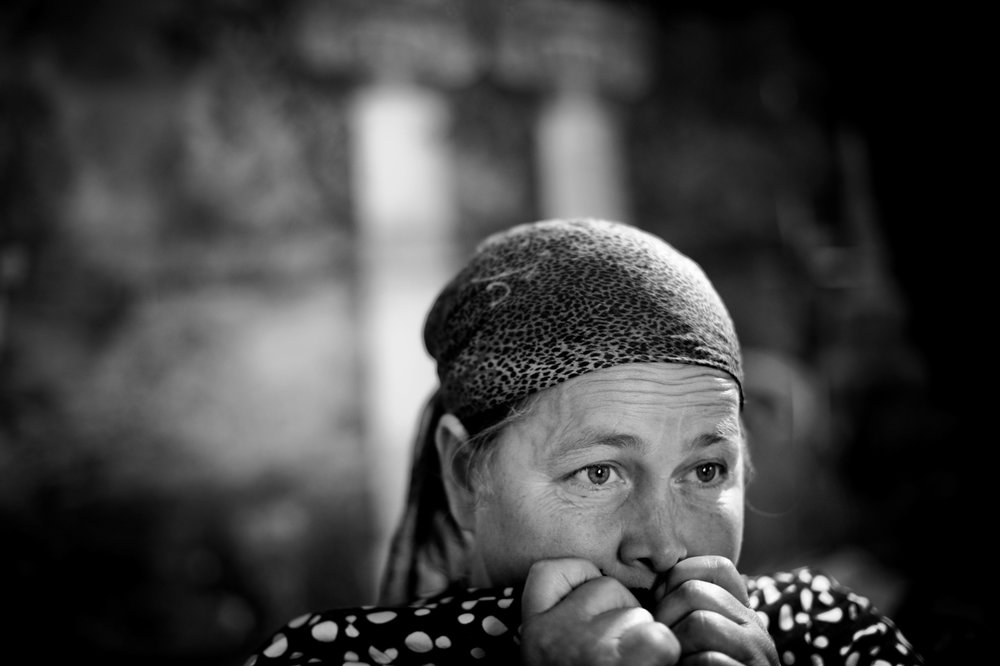 A Chechen refugee is frightened during a Russian police visit to the refugee camp where she lives.