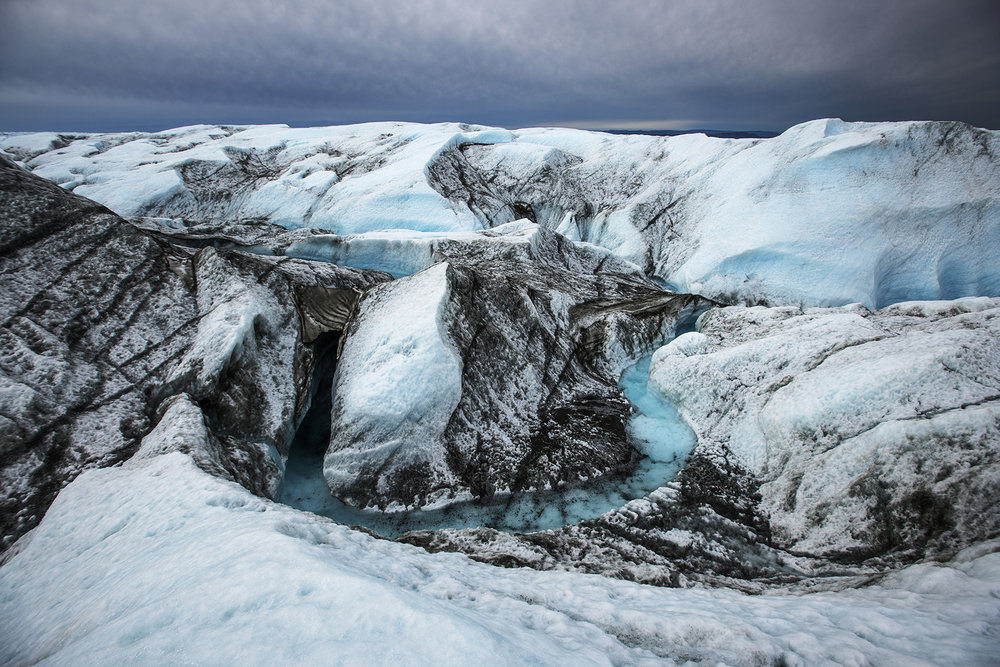 Greenland, Kangerlussuaq, July 2018Meltrivers close to the edge of the ice sheet close to Kangerlussuaq. In front a river of meltwater. Due to climate change the ice sheet slowly melts, not do glaciers retreat at a rapid speed also the ice sheet itself melts, forms melting streams and reservoirs where the meltwater forms underground rivers.Kadir van Lohuizen / NOOR for Carmignac Fondation