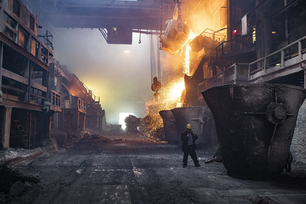 """Russia, Taymyr Peninsula, Norilsk, July 2018The copper factory.Three plants of Norilsk — the nickel factory, the copper factory and the metallurgical complex """"Nadejda"""" (""""Hope""""), were built successively in 1942, 1949 and 1981. 56% of the population works in these places. As part of plans to clean up Norilsk's reputation, in June of 2016 the company Norilsk Nickel shut down its nickel factory: a 74-year-old enterprise that emitted 350,000 tonnes of sulphur dioxide each year. But other plants in Norilsk have taken on the nickel factory's operations, while the final stages of production are being transferred to plants in the Murmansk region, which Norway has long accused of sending """"death clouds"""" of pollution across its border with Russia.Yuri Kozyrev / NOOR for Carmignac Foundation"""