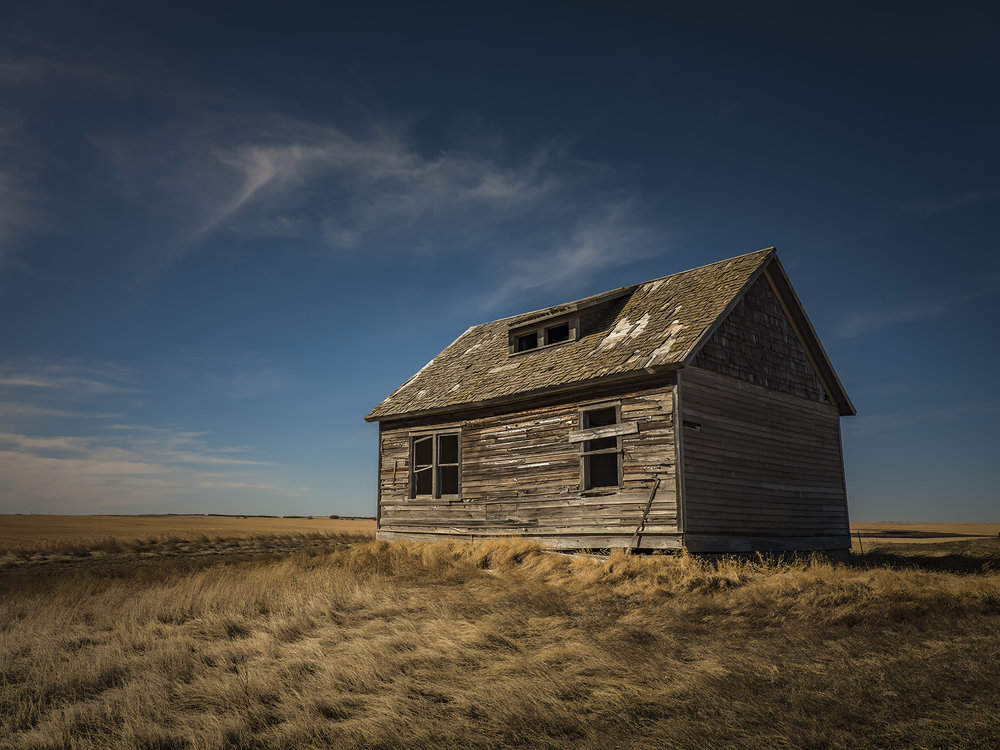 Sun-baked, wind-blown and abandoned, hundreds of these Andrew Wyeth-like buildings dot the prairie landscape