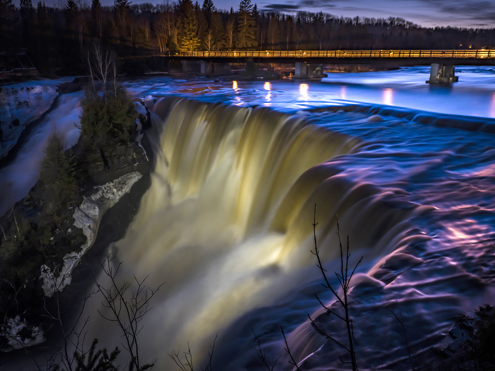 "Kakabeka Falls, a short distance west of Thunder Bay, is the ""Niagara of the North"" and never disappoints. In this 60-second exposure, the thundering falls appear so serene – don't be fooled!"