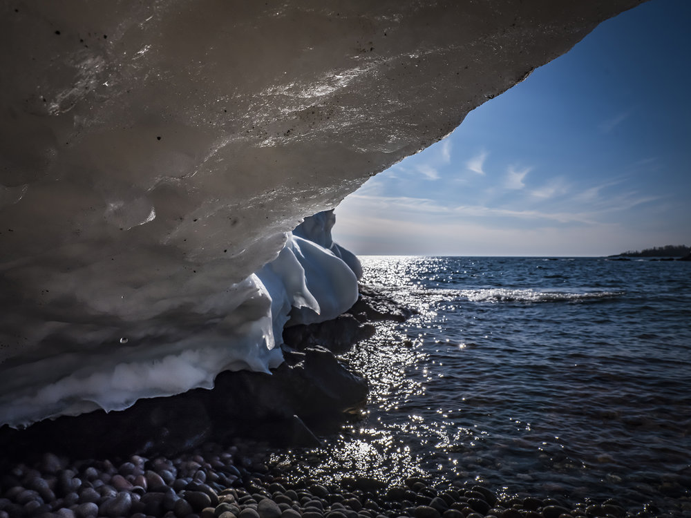 Laying under an ice shelf, Batchawana Bay spreads out to Lake Superior