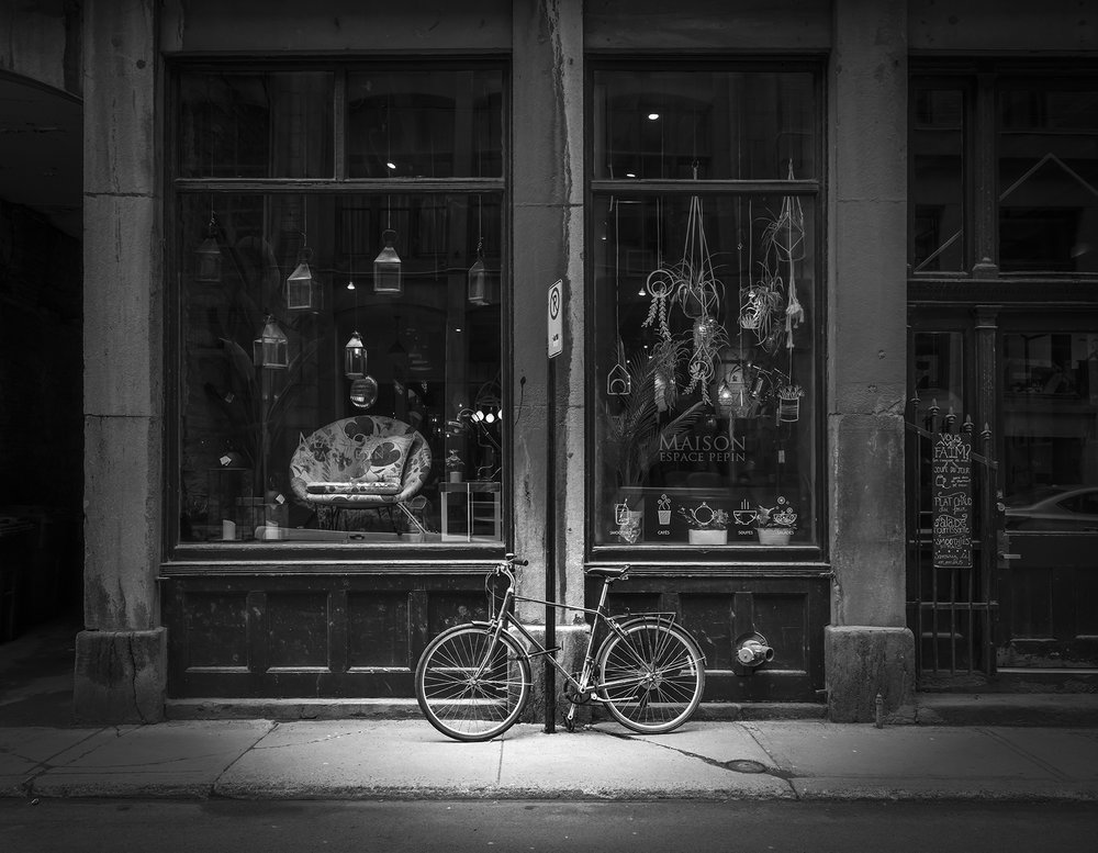 In Old Montreal, a bicycle awaits its rider inside this shop.