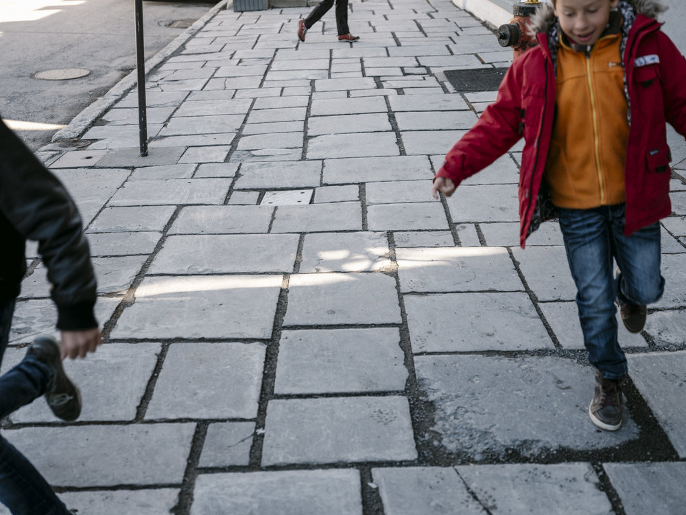 Children skip from paving stone-to stone. Photo by Renaud Philippe.