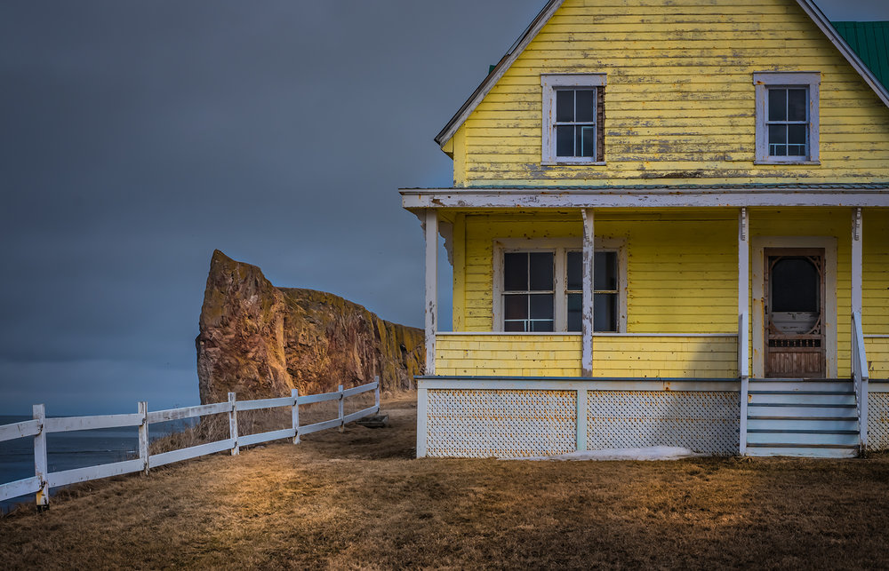 Portrait of a yellow house being photo-bombed by the likes of Percé
