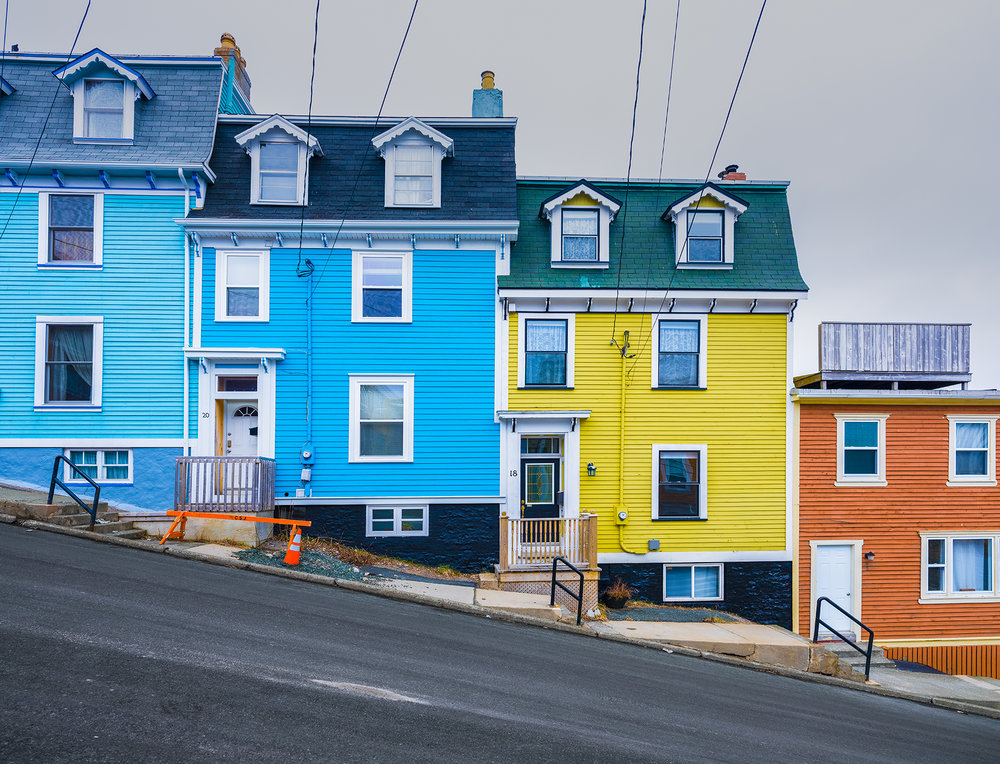 Candy-coloured homes on steep streets contrast with the grey and drab fog not far from town in St. John's