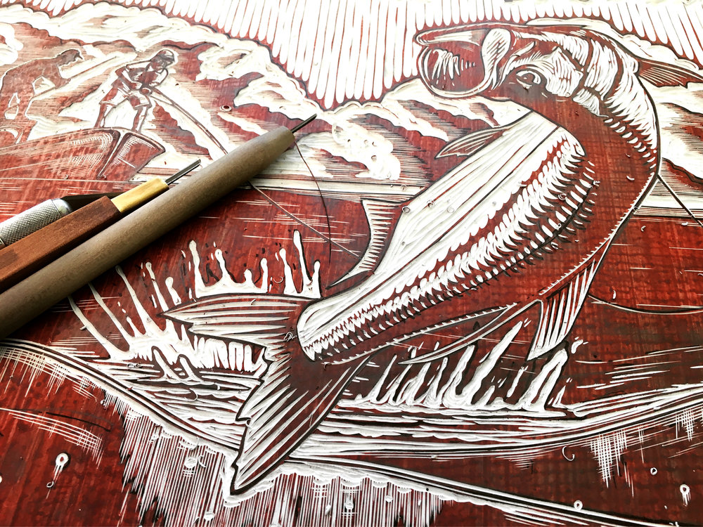 The intricate wood carving for the Tarponville Tournament print
