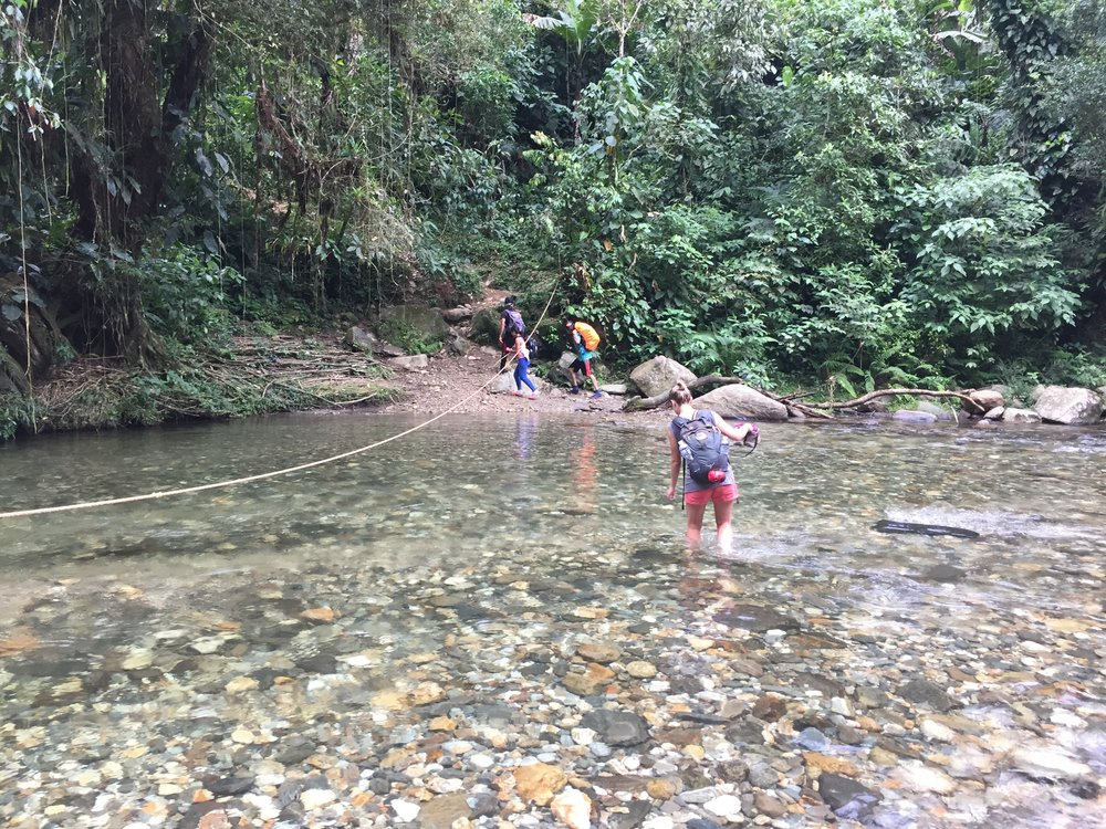 Wading through a river on a five day hike to the Lost City in the Jungle, Colombia. (This was a big deal for me I HATE spiders!!