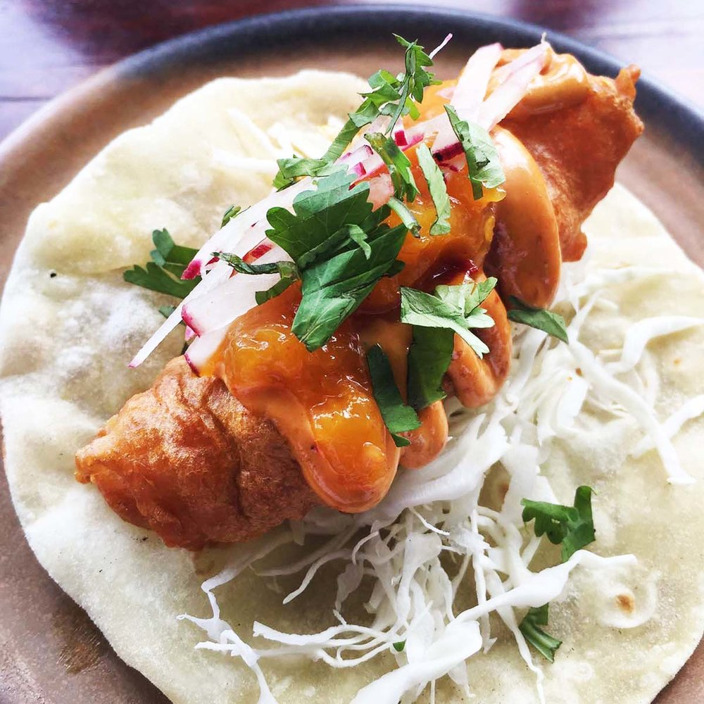 Fish taco, cabbage slaw, chipotle mayonnaise, mango salad, IDR35,000 (SGD2.60)