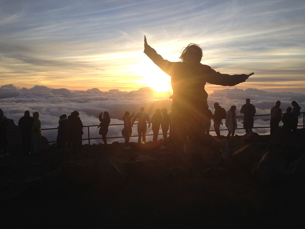 Watching the sunrise over the Haleakala Crater on Maui, Hawaii, just before biking down the crater