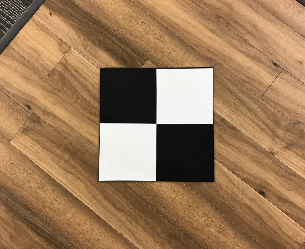 "This gcp was made with a sheet of  roofing rubber  ($4.66 each) and  vinyl stickers  ($1 per 6"" x 12"" sheet) to create a simple checker pattern that is highly weather resistant."