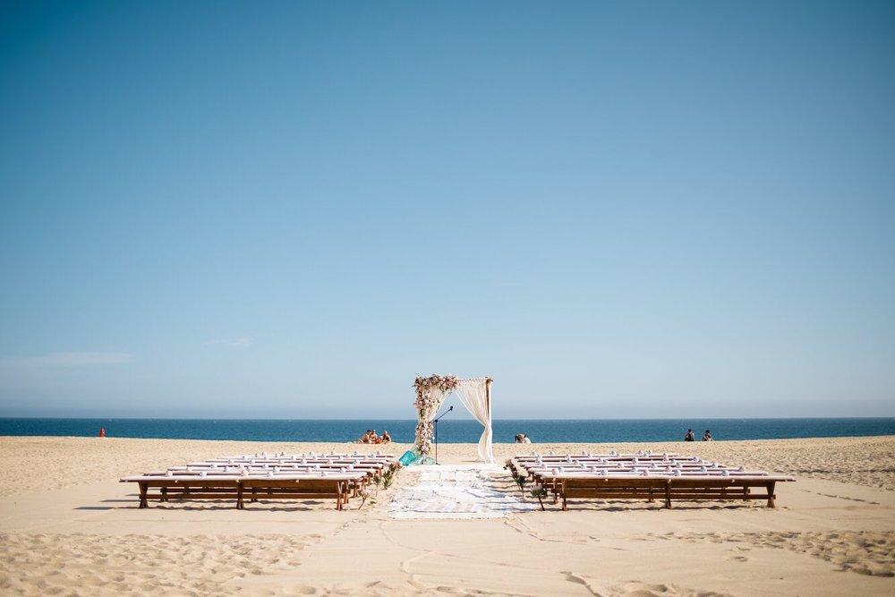 Photography:  Walter Wilson Studios   Venue:  Pueblo Bonito Sunset Beach   Florals & Design:  Florenta