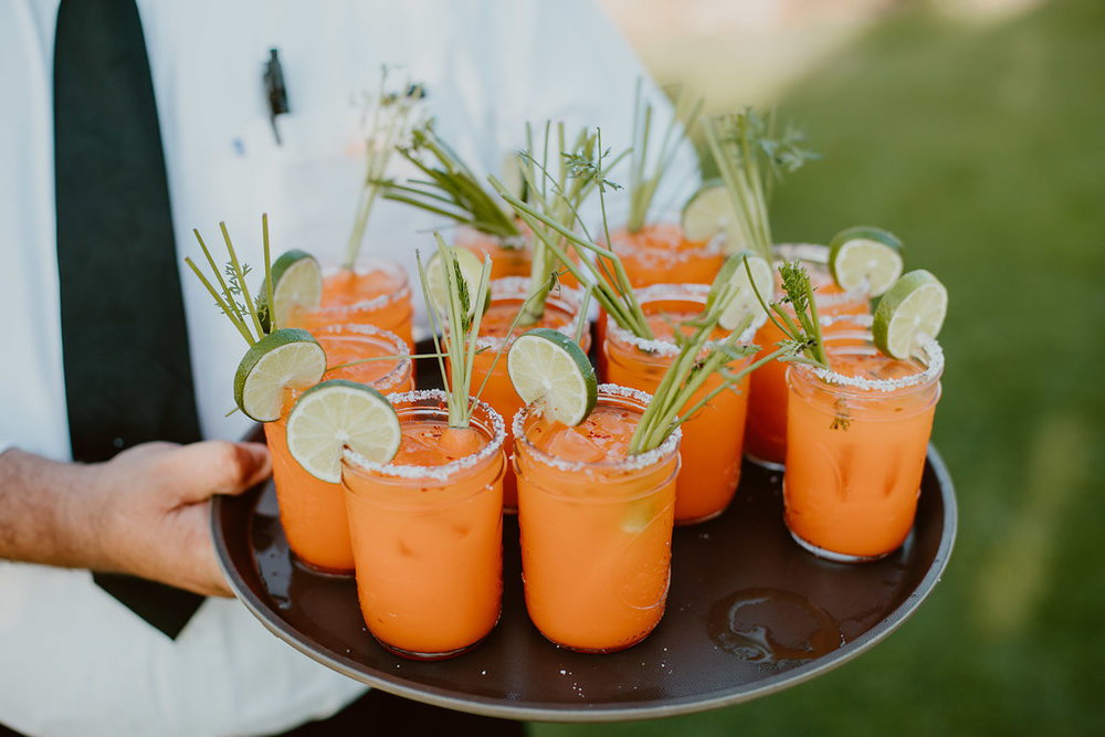 Photography:  Ana & Jerome  / Venue:  Flora Farms   Farmarita: Our farm fresh take on the classic made with heirloom carrot juice & reposed tequila