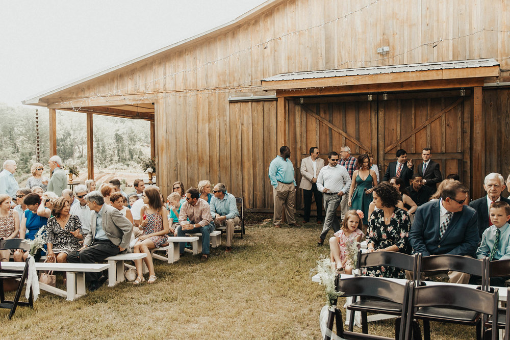 We were so worried it was going to rain during the ceremony since it had rained all morning! But the rain held off and we even got a little sunshine. Taylor was so beautiful and Andrew's reaction is TO DIE FOR. Just wait and see!