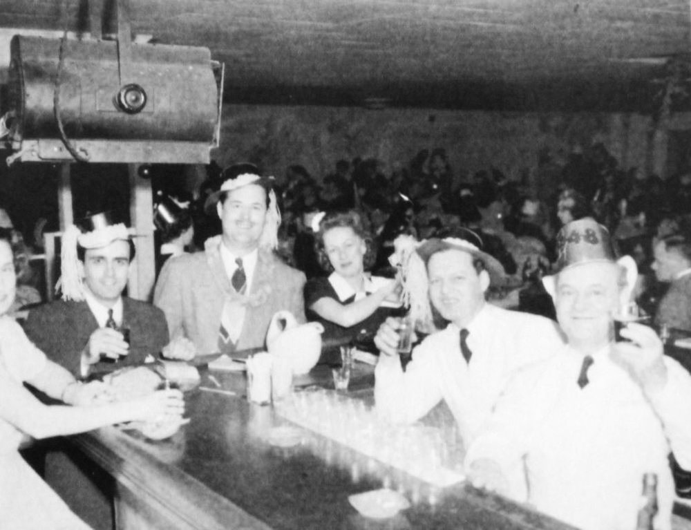 "New Year's Eve at the Lake Club during its heyday. Owner Huge Giovagnoli is in the dark suit at the end of the bar. The bartender who took the photograph that night may have been Albert ""Rudy"" Cranor."