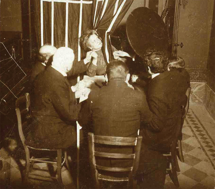 A scene from a Palladino seance, during which furniture in the room moved by itself (caught on film) and other events occurred.