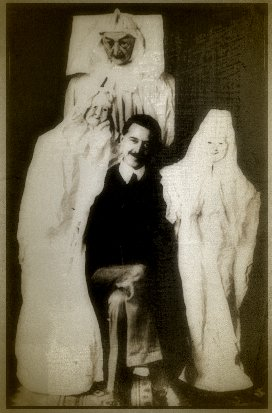 "Magician William S. Marriott with some of the ""ghosts"" that he bought from a catalog that sold tricks to phony spirit mediums"