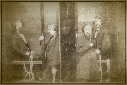 The Davenport brothers in their spirit cabinet -- which may have concealed the practice of fraud.