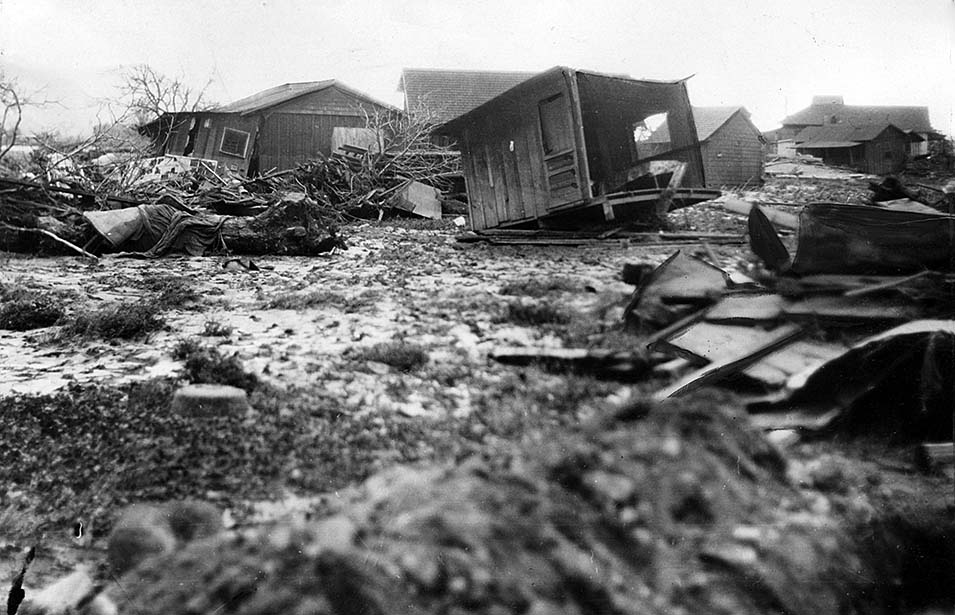 THE WALL OF WATER WIPED OUT ALL THE HOMES IN ITS PATH AND EVEN SHIFTED AN ENTIRE RAIL LINE FROM ITS TRACKS.
