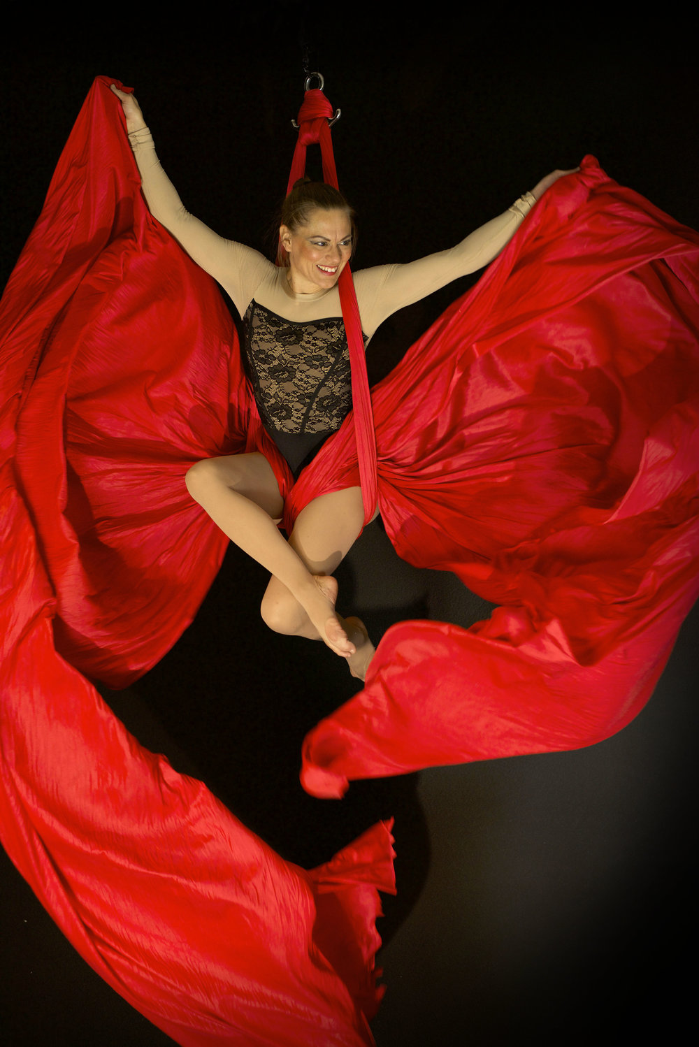 Holly Dison red aerial silks pose