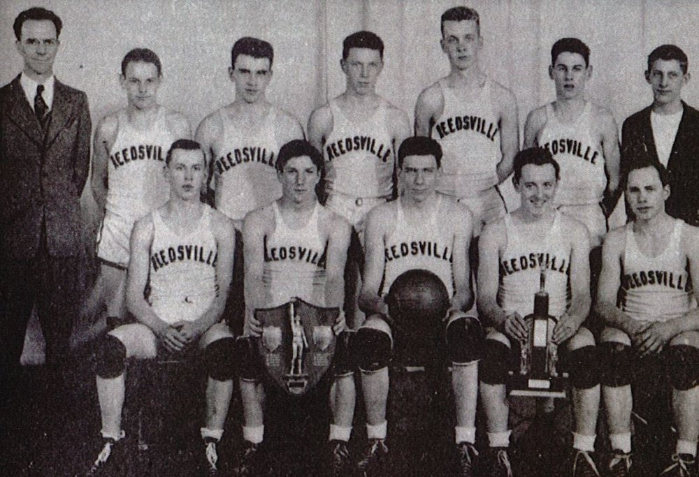 First row (left to right): Henry Behnke, Bernard Kubale, Ed Shimon, Roman Kugle, Karl Maertz. Second row: Coach John Gable, Reuben Rusch, Carlos Prochnow, James Ottlein, Harvey Waack, Leroy Eichhorst, Lyle Eichhorst