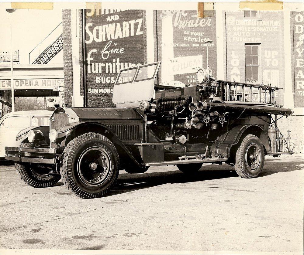 94.13.14: Engine No 1 - 600 gallon Pumper, put into service in 1910. Photo taken on 700 block on Chicago Street in Manitowoc, circa 1947.