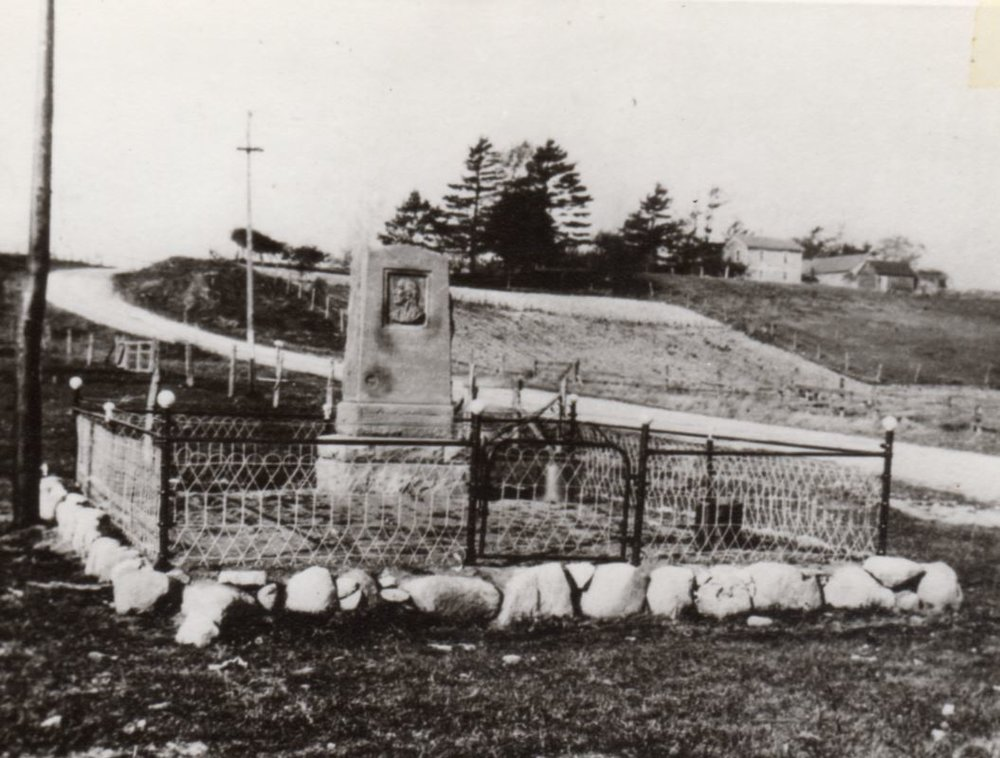 August 8, 1909: Chief Mexico Monument with Braunel farm in background.