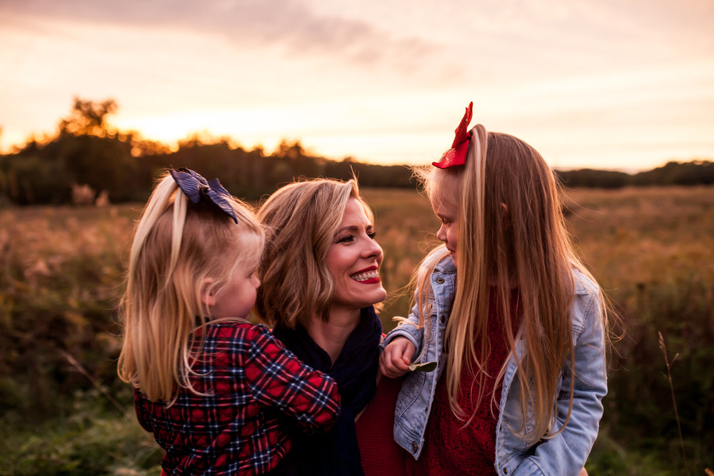 caitlin + Tony + family - October 2018 — Caitlin, Tony, and their two girls. We lucked out by being gifted with a beautiful, classic midwestern sunset right near the end of our shoot. That's always the best. So much love and sweetness! Caitlin and Tony have two very spunky girls. I could barely keep up.