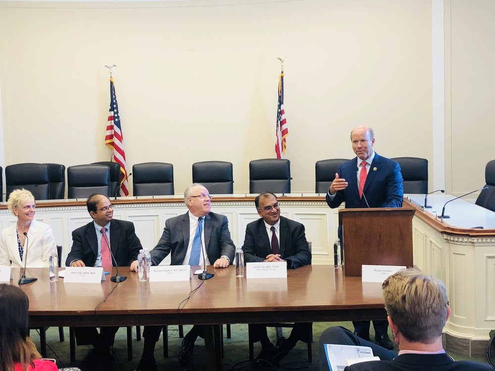 Rep. John Delaney addresses the AI panel. [L to R: Marla Phillips, Ph.D. (Xavier Health); Bakul Patel (FDA); Michael Hodgkins, M.D. (AMA); Anil Jain, Ph.D. (IBM); Rep. John Delaney (D-MD).]