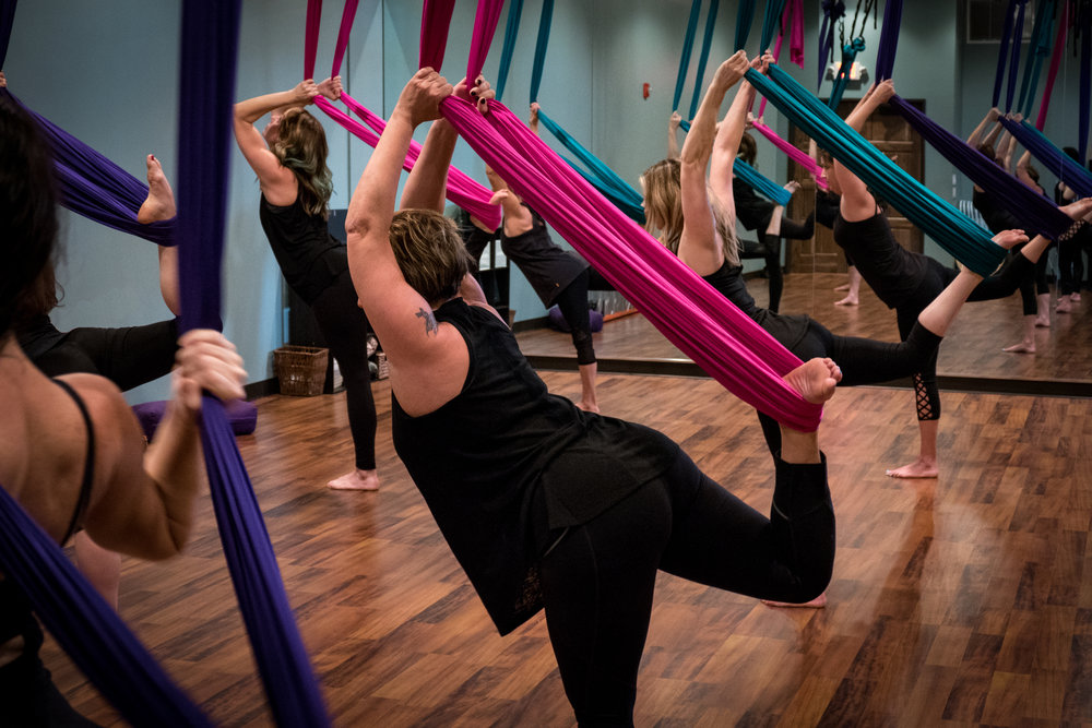 WHAT IS  ANTIGRAVITY YOGA? - The Wellness Center: Yoga & Therapies is the premier studio in Arizona to experience antigravity yoga classes!  This is the only facility to offer antigravity Aerial Yoga and Yoga Wall classes.  Classes are taught by certified aerial instructors.