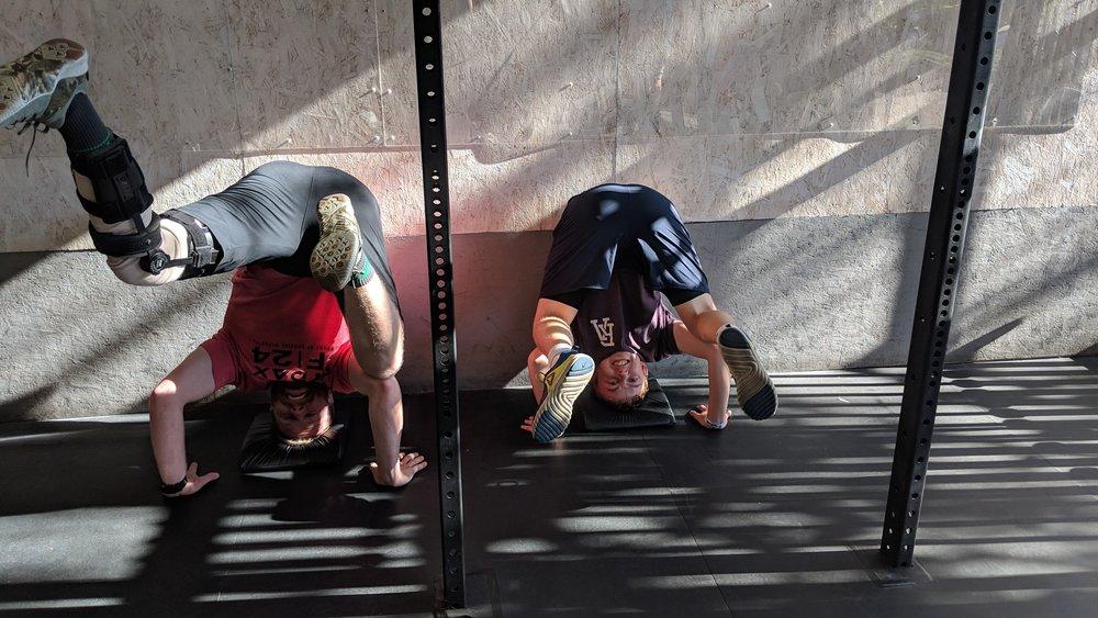Peter simon headstands fitclub.jpg