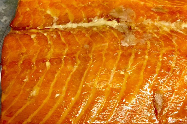 SMOKE NATURAL PIECES Custom cut and smoked with no liquid smoke, preservatives, chemicals, or dyes. Only sugar, salt and alder wood smoke. Our Natural Smoked Salmon is simple for those who love the taste of wood smoked salmon.