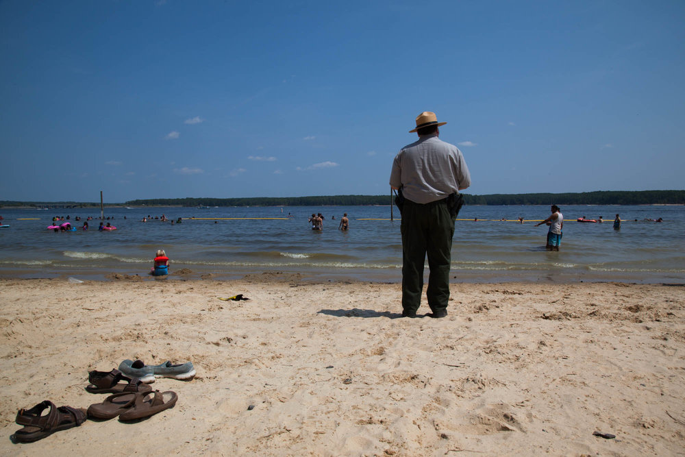 A Jordan Lake State Ranger surveys the crowds to make sure everything is as it should be on September 5, 2017.