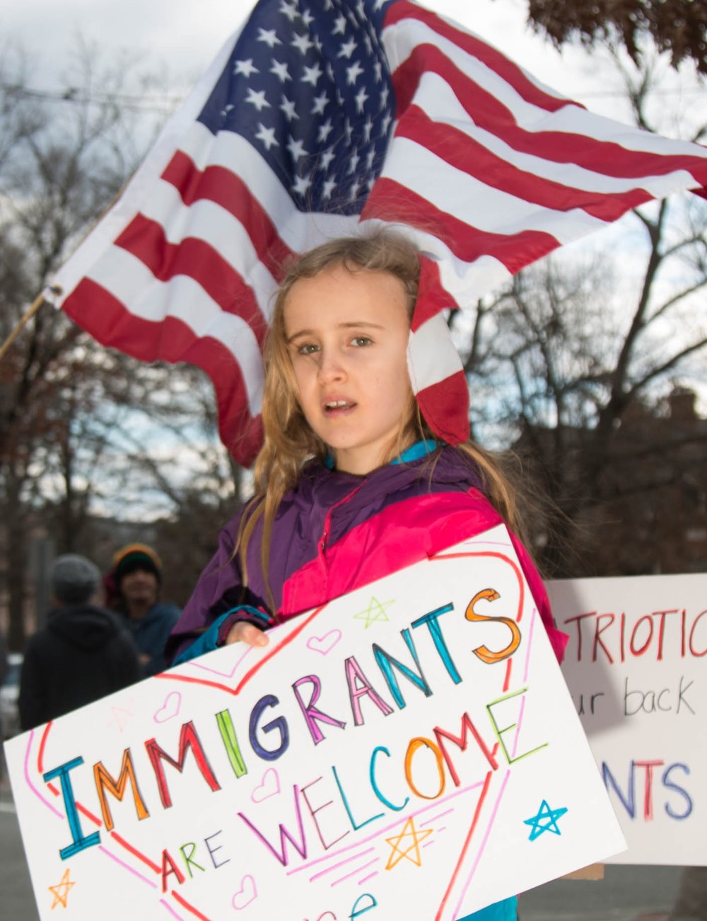 A girl takes part in a protest outside of the Chapel Hill Courthouse on Feb. 20, 2017.